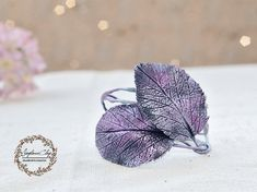 Flower are handmade by me products are made from polymer clay with metal thread inside, you can easily bend to fit your wrist   Our jewelry is not