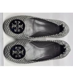 Tory Burch Reva Flats size 8M A Pair of TORY BURCH 'REVA'   Grey Calf Hair Ballet FLAT.   They have a spotted/animal print look. Very comfy. Shows signs of wearing. Please look closely, as I don't accept return. No original box.  SIZE 8M Tory Burch Shoes Flats & Loafers