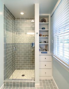 Basement bathroom – shower tile + built in shelving tucked into corner, great for small space