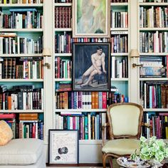 Love the wall of books..teal behind the books is interesting