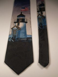 This is a Steven Harris MENS NECK TIE picturing a Lighthouse theme. Nautical!