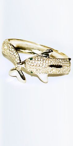 Meghan Fabulous Dolphine Bracelet. Love the green eyes. And I love dolphins.