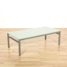 This modern coffee table is featured in a metal with a gray brushed chrome finish. This coffee table has simple straight legs and a frosted glass table top. Great for a minimalist living room! #contemporary #tables #coffeetable #sandiegovintage #vintagefurniture