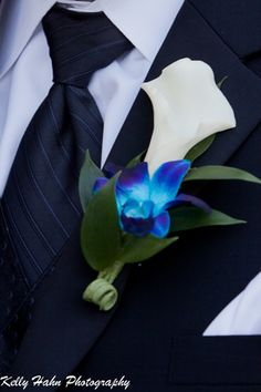Calla lily with blue dendrobium orchid by britney