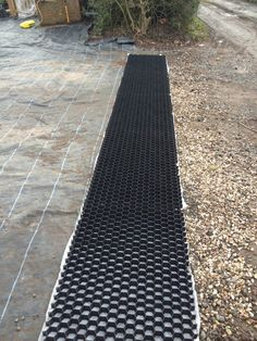 Gravel grids used to stabilize gravel driveways and