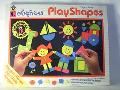 Colorforms, they were plastic and you stuck them on a shiny black surface. They had a real plastic whiff