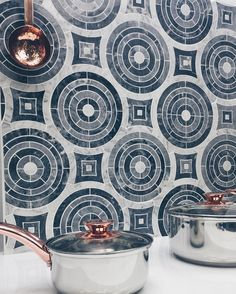 It's the circle of tiiiles  Taking waterjet mosaic to the next level with our 'Spin' Bardiglio and Carrara tile from our 'Eighties by Krista' collection @designpalmbeach #circles #waterjet #backsplash #copper #mosaic #marble #bardiglio #carrra #shadesofgray #pots #cooking #kitchendesign #walltile #floortile #pattern #circle #spin #eighties #tbt #throwback #tileaddiction #designtime #tilelover #tilework #backsplashtile #kitchen #celebrity #interiordbsigner #photography #art by tilebar