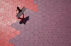 Benidorm's promenade features an undulating rainbow of circular ceramic tile by Spanish manufacturer Keramia. Photo by Alejo Bague.