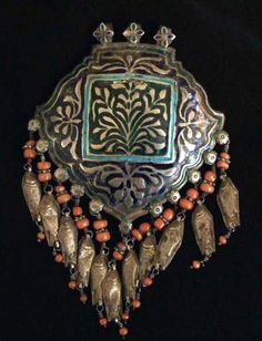 "India | End of braid ornament ""jutti""; silver, coral and enamel | Himachal Pradesh region | Sold"
