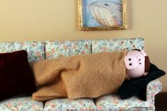 Happy Pig in a Blanket Day - cuddlesandrage.com  Middle Aged Pig looks so cute and comfy here.
