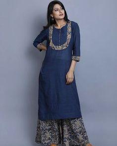 """A simplistic Khadi kurta detailed with Kalamkari and paired with an indigo mul Kalamkari palazzo.…"""