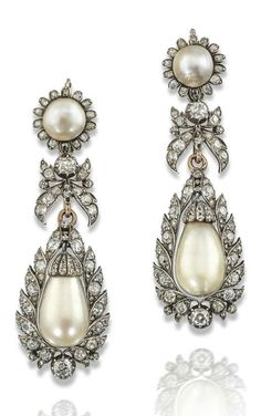 A pair of antique natural pearl and diamond drop earrings, 19th century. Each drop-shaped fully drilled pearl set with cushion-shaped and rose-cut diamonds in silver and gold foliate mount, suspending from conforming and detachable upper section set with pearls and diamonds. 7cm high. #antique #earrings