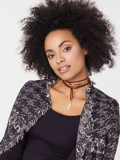Suit up in this ultra-chic statement choker, featuring a plush ribbon, gold band and dramatic tasseling. Set includes 2 chokers.