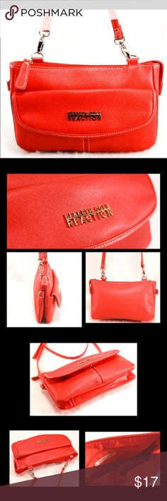 """KENNETH COLE REACTION Red Saffiano Style Purse KENNETH COLE REACTION Berry Red Saffiano Style Envelope Purse with Crossbody or Shoulder Strap.  Silver tone hardware, adjustable buckled long strap, snap closure on front envelope pocket, interior zip pocket and two slip pockets on red interior, and overall top zip closure.  Some minor wear to outside due to prior usage.  Man-made materials.  Very trendy bag with classic lines.  9.5x6x1.5"""" with adjustable strap now set to 24"""".  Orig. $48.00…"""