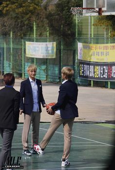 Kris playing Basketball and,Tao just looking,ever so adorable