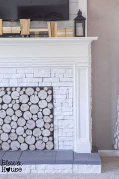 Wow. Just, Wow. We love this DIY Faux Fireplace. By Blesser House on Remodelaholic. #Remodelaholic #DIYfauxfireplace