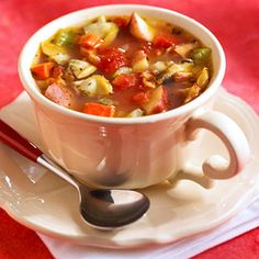 Clams are the traditional seafood choice for this tomato-based vegetable soup. This recipe adds bacon into the broth as well.