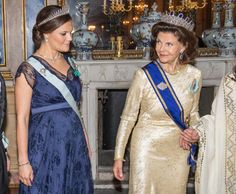 Queen Silvia glances over at her pregnant daughter Crown Princess Victoria during a state banquet at the Royal Palace in Stockholm on Wednesday.
