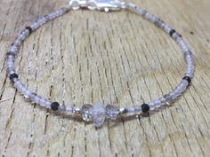 A personal favourite from my Etsy shop https://www.etsy.com/no-en/listing/578133912/herkimer-diamond-bracelet-black-rutile