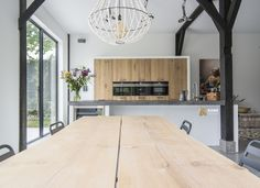 Tree trunk table in a Koak Design kitchen