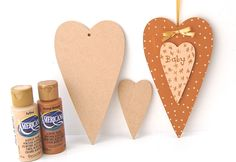 Our wooden hearts have been basecoated with acrylics and personalised for a DIY baby gift.