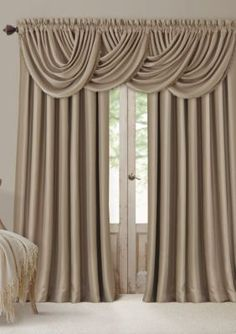 Complete the look of your Elrene All Seasons Window Panel Collection window treatments with the coordinating waterfall valance. The elegant silk-look valance features blackout and energy efficiency te