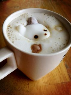 Drowning Panda Bear Latte Art. A creative use of a marshmallow gives this sweet effect :)