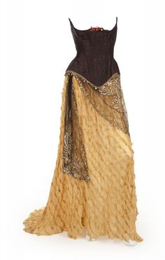 Costume from Phantom of the Opera. The costume is comprised of a yellow crepe dress with black overlay at bodice and down skirt with gold scarf at waist. Pretty concept.