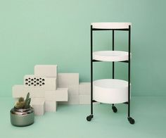 Karussell is a multifunctional side table, consisting of separate elements which can be arranged in different compositions to various heights.  http://vurni.com/karussell-side-table-shelf-or-trolley/