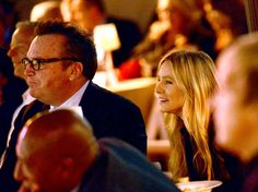 Tom Arnold & Kristen Bell, two great comedians watching more great comedians at Beverly Hills Hotel 100th Anniversary Celebration