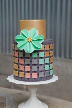 The harsh modern look of this geometric cake cake is softened by the big fluffy teal flower Beautiful Wedding Cakes, Gorgeous Cakes, Pretty Cakes, Cute Cakes, Amazing Cakes, Modern Cakes, Unique Cakes, Elegant Cakes, Creative Cakes
