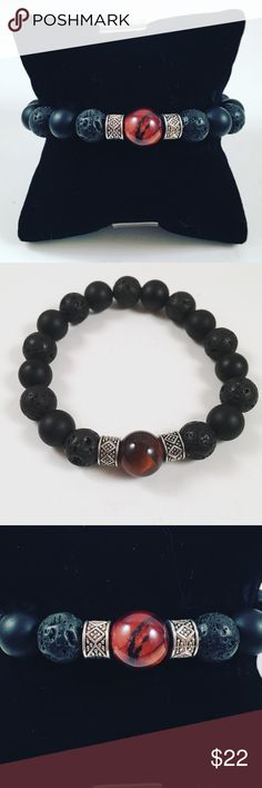 Men Red Tiger eye and lava rock beaded bracelet. Men beaded bracelet. Fits most 7.5 to 8.5 inch wrist. Handmade by me , never worn by anyone. Made with black lava rocks , a Red tiger eye in the middle. Two tibetan silver deco beads. I ship fast!!✈️ Free gift with every purchase !! Accessories Jewelry