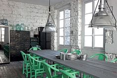 Stunning muted kitchen with vivid green chairs
