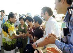 Daisaku Ikeda greeting participants at the SGI launch in Guam, 1975