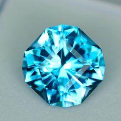 MJ2574 - 3.69ct electric blue Topaz - Brazil 9.36 x 6.09 mm clean, custom cut, irradiated, $85 including shipping