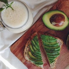Simple avocado on toasted multigrain bread and vanilla banana smoothie for lunch