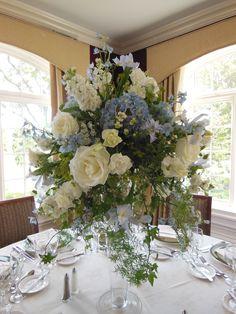 Wedding Reception Flowers | Bedford Village Florist | Westchester New York | Tall blue and white centerpiece | Beautiful floral arrangement of roses, ivy, hydrangea
