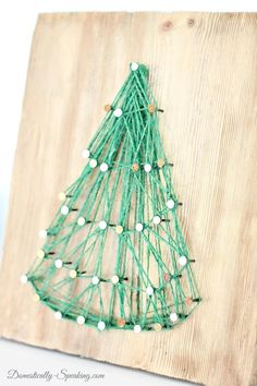 DIY String Art Christmas Tree is a great holiday project. It makes a great Christmas gift too! Get the full tutorial on how to make this Christmas tree! Great Christmas Gifts, Christmas Projects, Christmas Tree, Christmas Ideas, Crafts For Teens, Arts And Crafts, Diy Crafts, Decor Crafts, Diy Blanket Ladder
