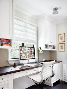 This office has all the makings of a studio - great chair, lots of cabinets and drawers, plus lots of top space.