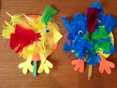 Easter chicks with feathers and googly eyes.
