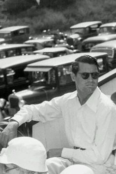 I love this photo of Cary Grant....not just because he's looking so good, which he most certainly is......but because I love all the cars parked up in the background....