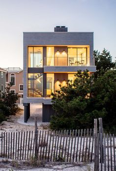 Specht Architects have designed this new contemporary house on Long Island Beach in New Jersey, that's a replacement for a home that was destroyed in Hurricane Sandy in 2012.