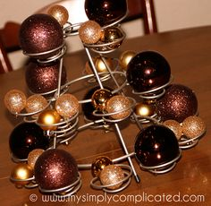 A cupcake stand with ornaments for Christmas decorations!