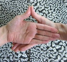 Photo gallery of various Buddhist hand gestures (mudras) used in yoga practice, meditation, and for healing purposes.: Buddha Mudra