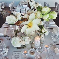 11 table settings to inspire your next lunch : Grandiflora's giant Magnolia and Lotus flowers anchor this all-white table setting.  @grandiflora