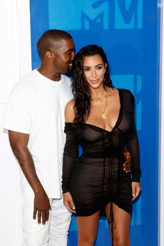 Kanye West kept it simple while Kim Kardashian stole the spotlight at the 2016 MTV Video Music Awards. Love her wet-'n'-wavy hair and a sheer, V-neck LBD that hung off one shoulder.