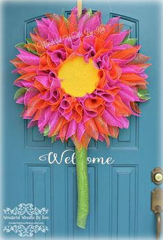 Colors used in the wreath pictured above - Hot Pink and Orange Petals, Green Leaves and Stem with a yellow center Gerbera Daisy This flower wreath can be customized! Perfect for any season.These wreaths look wonderful on doors, windows and even on your patio. This wreath measures approximately 26 inches in diameter and 38 inches in length (with stem) The possibilities are endless. You choose the color(s) - centerpiece will be yellow, leaves and stem will be green unless otherwise noted…