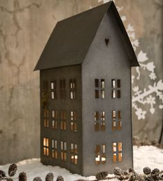 zinc candle holder shaped like a house - I want a whole town of these in different sizes on a shelf or window sill.