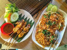 My go-to meal in Bali (and it also happened to be $2.50). Chicken satay and seafood mie goreng (fried noodles). by jackieeats