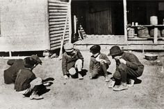 4 brothers and a friend playing marbles in rural Scurry County, somewhere near Snyder, Texas-1915...